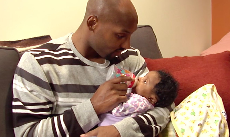 Dad talking to baby to help build babies' brains